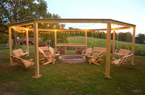This pergola has everything you could ever want. It is a rounded shape  where swings can actually hang from the structure. - 51 DIY Pergola Plans & Ideas You Can Build In Your Garden (Free)