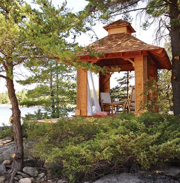 This Gazebo Looks Like A Scene Out Of Paradise. It Has A Raised Floor And  An Interesting Roof Line That Catches Your Attention At First Glance.