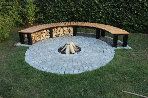 57 inspiring diy outdoor fire pit ideas to make smores with your family it isnt as solid as a fire pit but instead they created this neat indented place for wood to be neatly stacked solutioingenieria Gallery