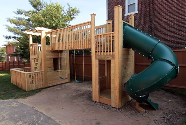 This Playset Is Larger And Looks Like Tons Of Fun. It Has A Slide On One  End And Swings On The Other. It Also Contains An Area Where Kids Can Climb  Through ...