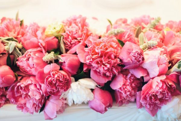 floral arrangement of pink peonies with leaves