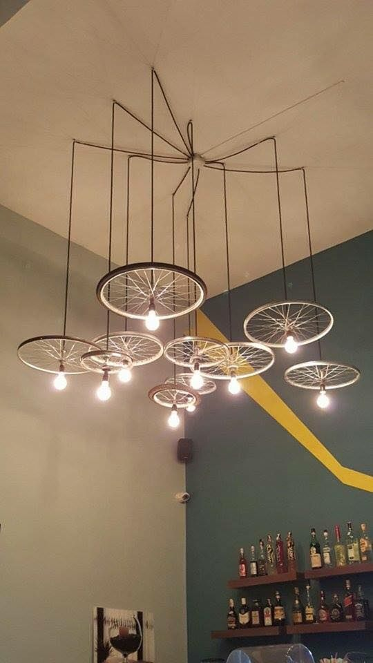 34 beautiful diy chandelier ideas that will light up your home the bicycle chandelier aloadofball Gallery