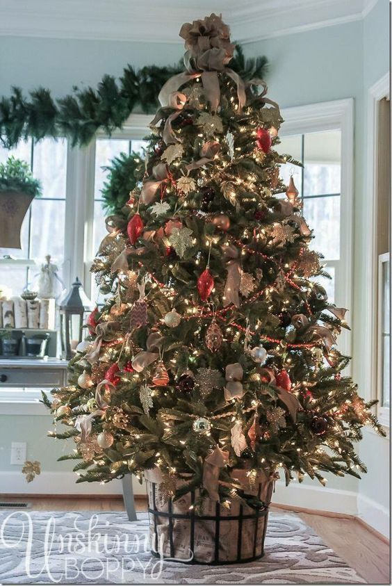 i love this idea for decorating your christmas tree because you can still go traditional on the actual tree dcor