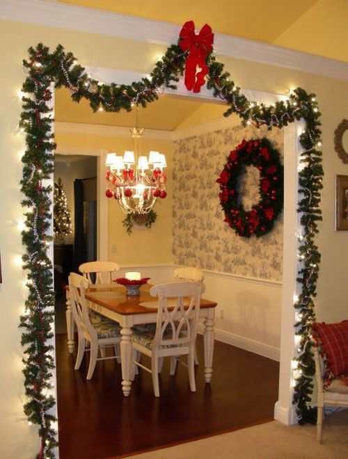 this is another example of how you can decorate a doorway in your home with garland you may need to have a larger home to pull this off