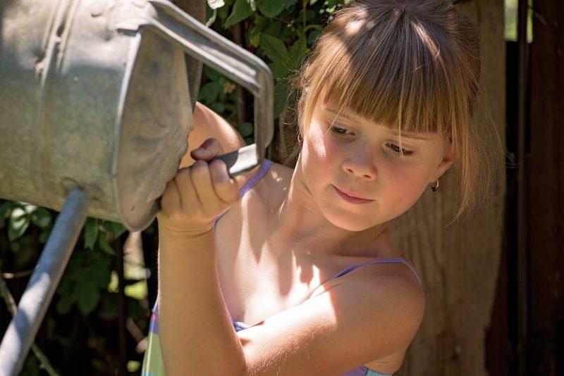 Child watering container garden
