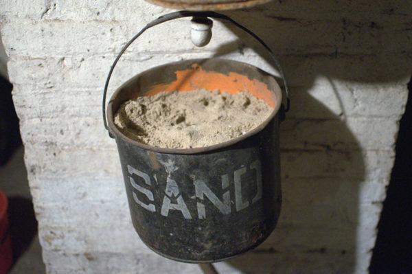 A black bucket full of sand