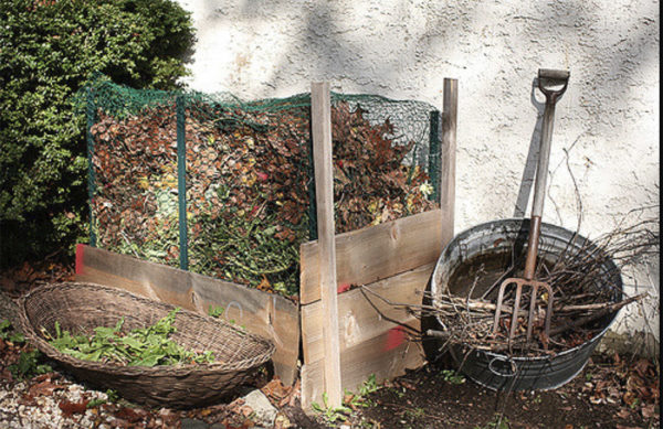 Composting 101 pile next to a house