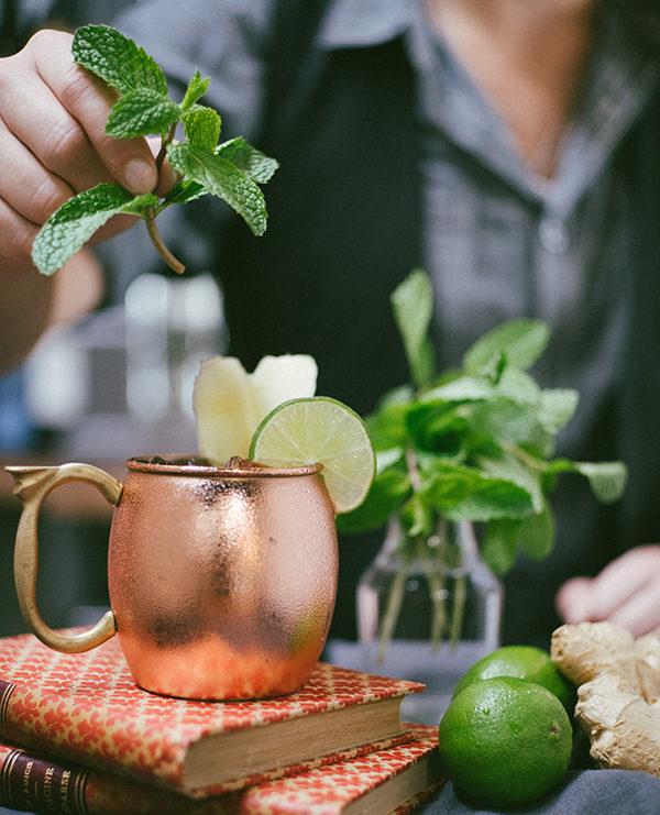 Mint next to a copper mug